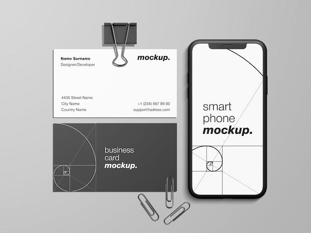 Biglietti da visita e modello moderni del modello dello smartphone con le graffette e il paraocchi Psd Premium