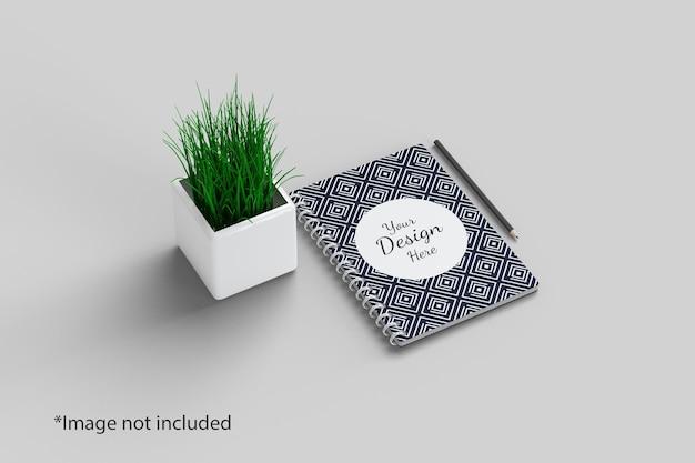 Vista ad angolo retto del mockup del notebook con la pianta Psd Premium