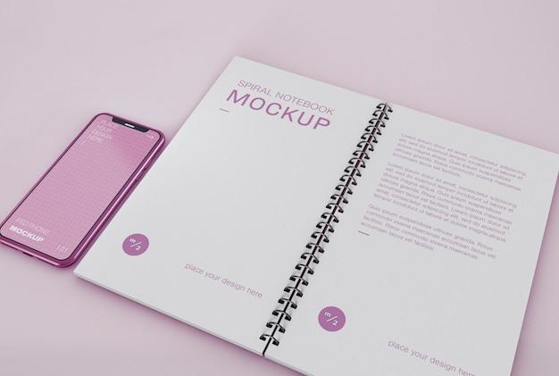Telefono con spirale notebook mockup Psd Premium