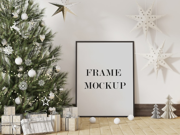 Mockup di cornice immagine accanto all'albero di natale Psd Premium