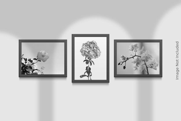 Mockup di cornici realistiche appeso al muro con sovrapposizione di ombre Psd Premium