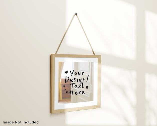 Specchio quadrato riflettente appeso al modello a parete Psd Premium