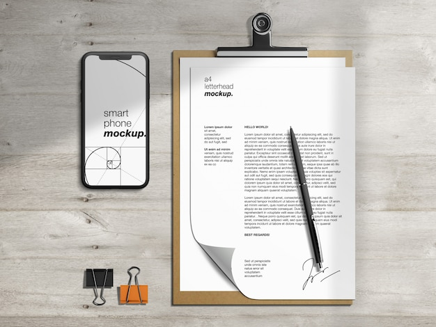 Modello di carta intestata appunti e modello di smartphone di cancelleria con paraocchi penna e carta Psd Premium