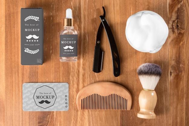 Vista dall'alto di prodotti da barbiere con pettine Psd Premium