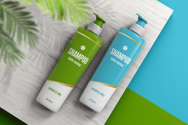 Una bottiglia di due shampoo sul modello di superficie di legno Psd Premium