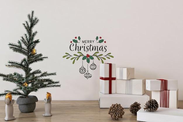 Mockup da parete nel concetto di natale con albero di natale e decorazioni Psd Premium