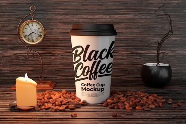 Mockup di tazza di caffè bianco con decorazioni di candele e chicchi di caffè Psd Premium
