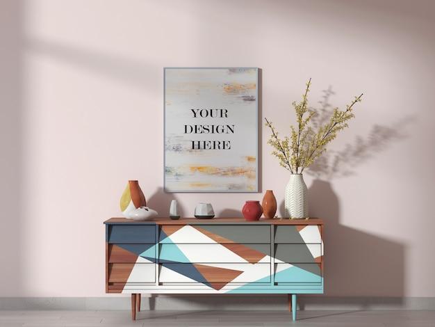 Mockup di cornice immagine bianca sulla parete rosa nella stanza luminosa con credenza Psd Premium