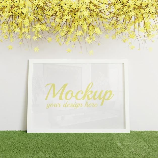 Mockup bianco cornice verticale in piedi sull'erba artificiale verde Psd Premium