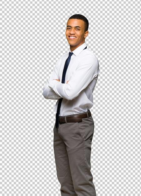 Giovane uomo d'affari afro americano che osserva sopra la spalla con un sorriso Psd Premium