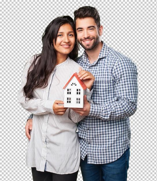Giovani coppie che tengono una casa Psd Premium