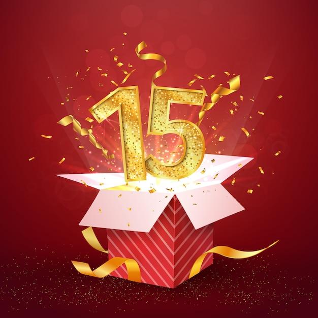 15 ° anniversario e confezione regalo aperta con coriandoli di esplosioni. Vettore Premium