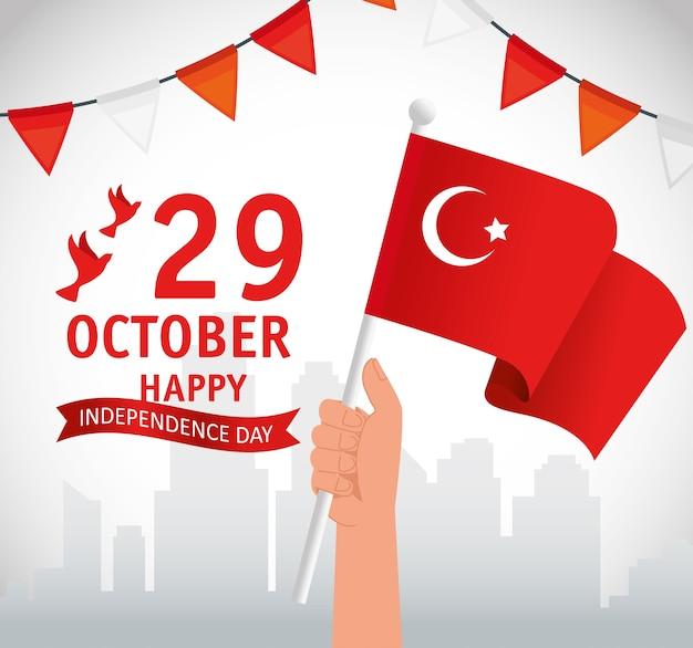 29 ottobre festa della repubblica turchia e mano con bandiera Vettore Premium