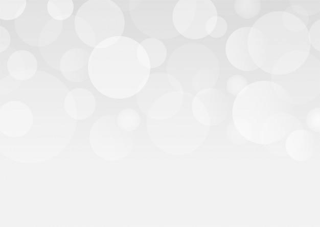 Fondo grigio astratto di effetto delle luci del bokeh. Vettore Premium