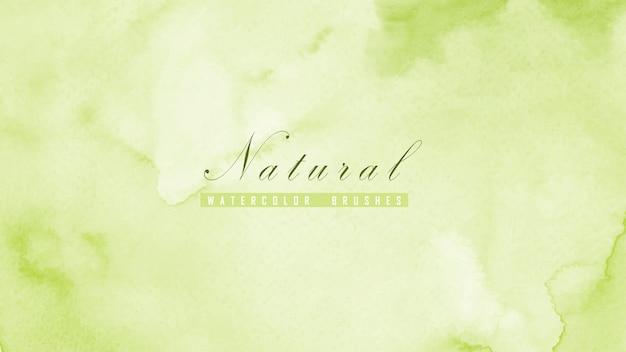 Sfondo naturale astratto progettato con macchie di acquerello verde. Vettore Premium