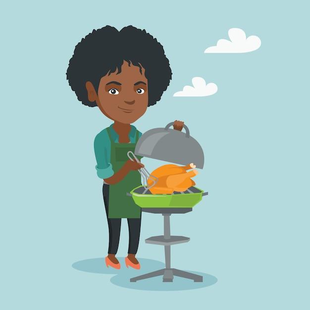 Donna africana che cucina pollo sul barbecue. Vettore Premium