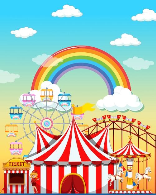 Scena del parco di divertimenti di giorno con l'arcobaleno nel cielo Vettore Premium