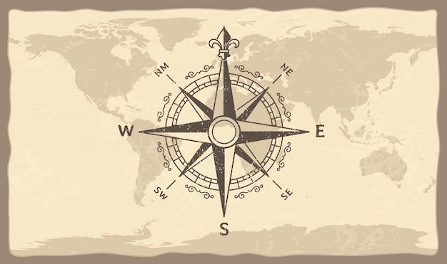Bussola antica sulla mappa del mondo Vettore Premium