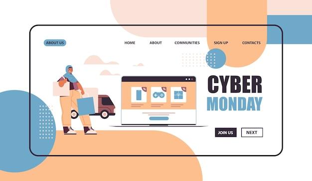 Donna araba con le borse della spesa scegliendo le merci sullo schermo del laptop shopping online cyber lunedì grande vendita concetto copia spazio Vettore Premium