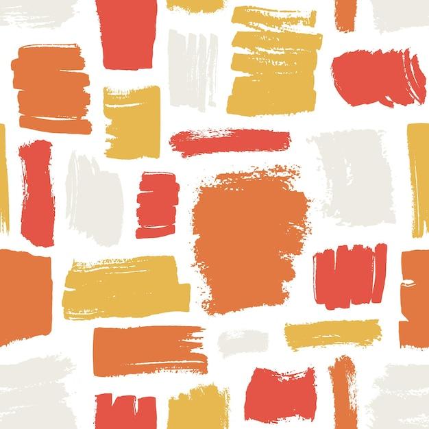 Modello senza cuciture artistico con pennellate rosse, arancioni, gialle su sfondo bianco Vettore Premium