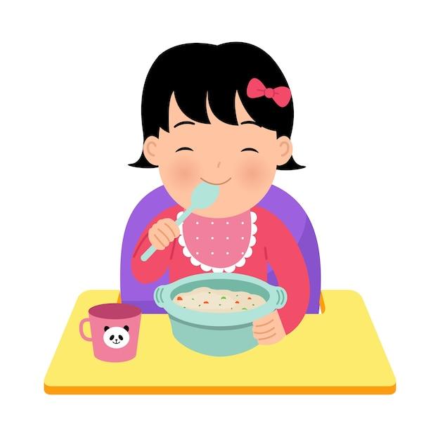 Ragazza asiatica del bambino che si siede sulla sedia del bambino che mangia una ciotola di porridge da sola. illustrazione genitoriale felice. giornata mondiale dei bambini. in sfondo bianco. Vettore Premium