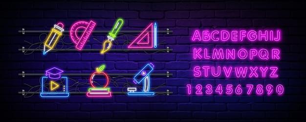 Torna a scuola insegna al neon e alfabeto. Vettore Premium