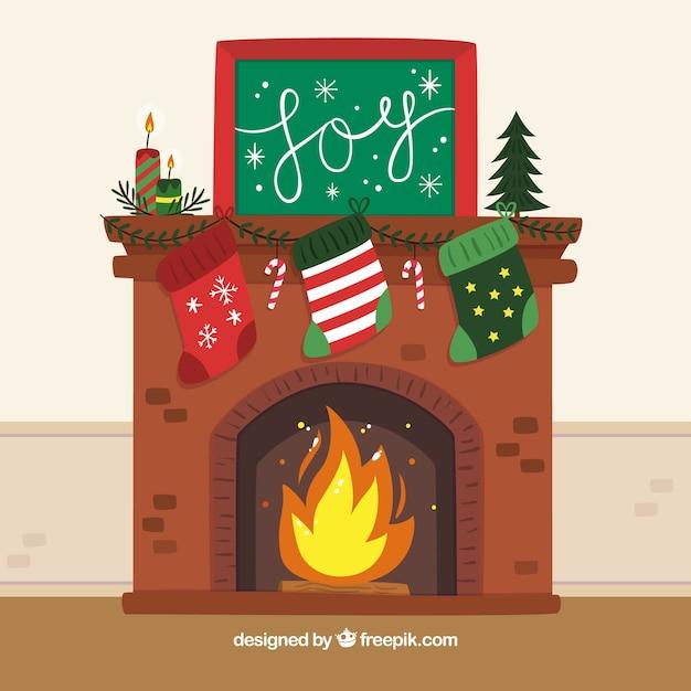 Sfondo di un camino con decorazioni natalizie Vettore Premium