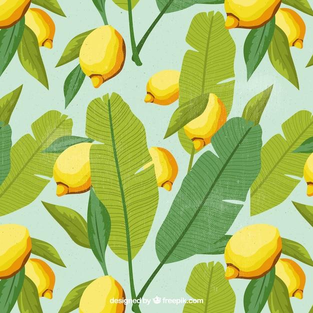 Sfondo di foglie di palma e limoni Vettore Premium