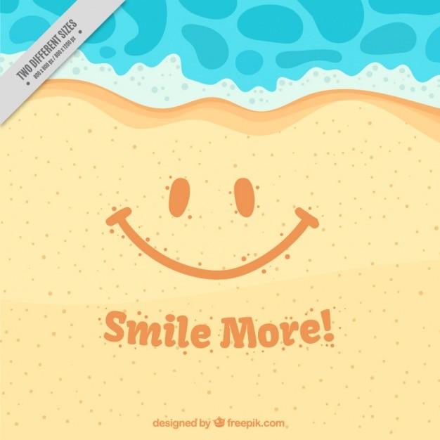 Sfondo sorriso sulla sabbia con il messaggio