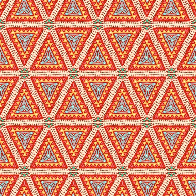 Bellissimo modello senza cuciture di colore tribale grafico con triangoli arancioni Vettore Premium