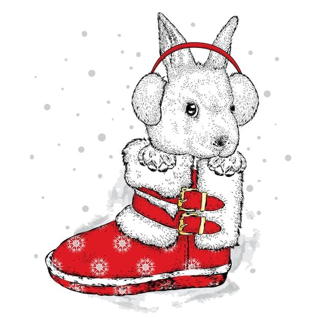 Bella lepre in una cuffia invernale. Vettore Premium