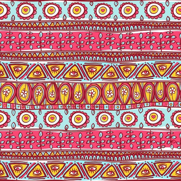 Bello ornamento rosa e blu senza cuciture a strisce tribali Vettore Premium
