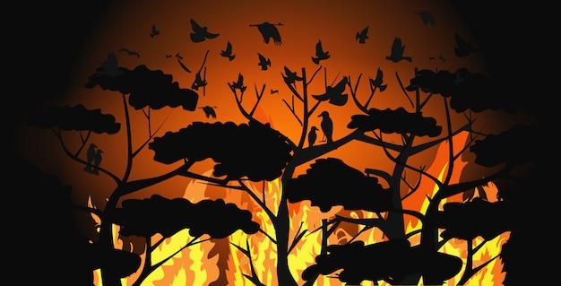 Sagome di uccelli che sorvolano la foresta di incendi fuggendo dagli incendi in australia animali che muoiono in incendi boschivi disastro naturale concetto intenso arancione fiamme orizzontale Vettore Premium
