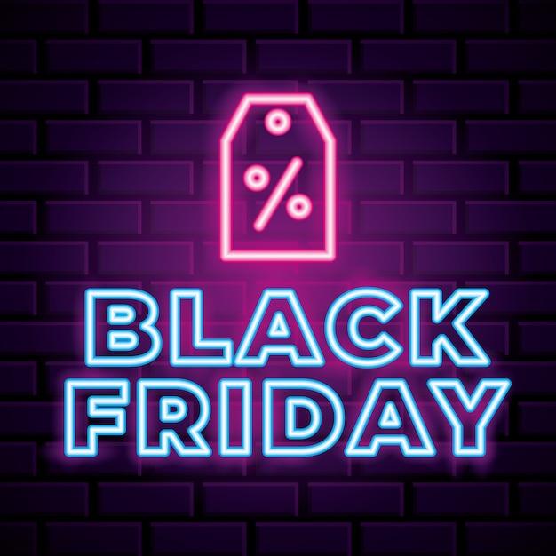 Insegna al neon di venerdì nero con l'icona dell'etichetta sopra la priorità bassa del muro di mattoni Vettore Premium