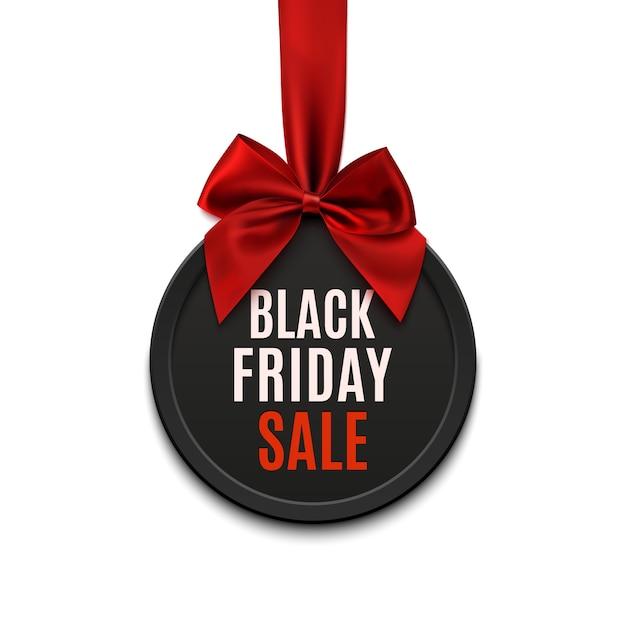 Bandiera rotonda di vendita del black friday con nastro rosso e fiocco Vettore Premium