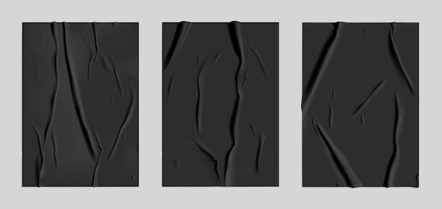 Set carta nera incollata con effetto stropicciato bagnato. modello di poster di carta bagnata nera con struttura sgualcita. mockup di manifesti vettoriali realistici Vettore Premium