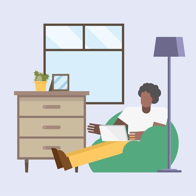 Uomo nero con laptop lavorando su puf da casa design del tema del telelavoro illustrazione vettoriale Vettore Premium