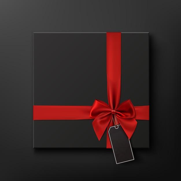 Scatola regalo vuota, nera con nastro rosso e cartellino del prezzo. fondo concettuale di vendita del black friday. illustrazione. Vettore Premium