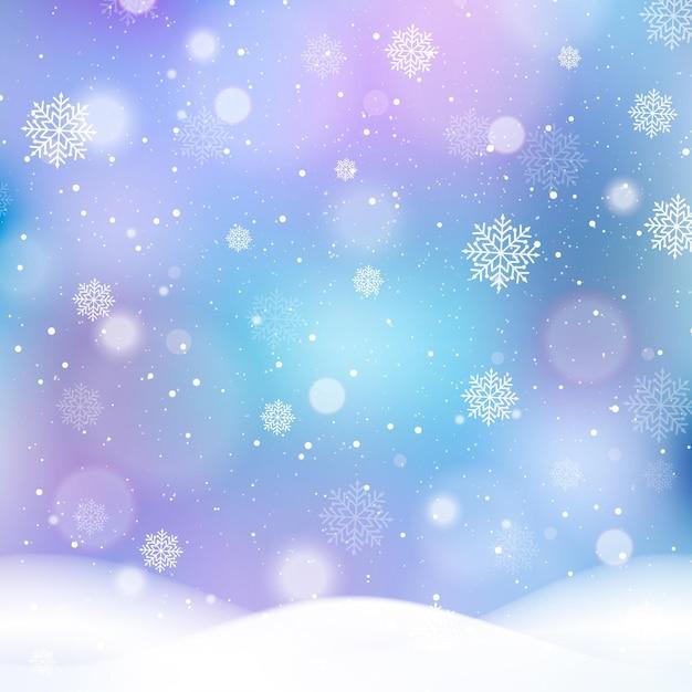 Sfondo sfocato invernale con fiocchi di neve Vettore Premium