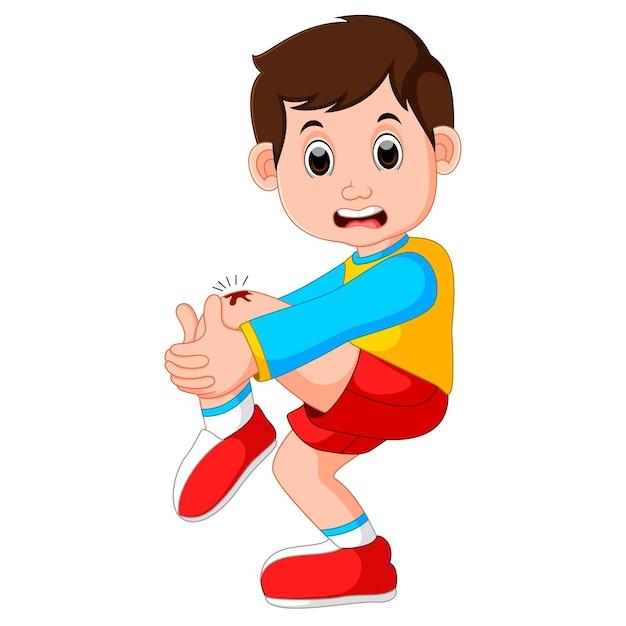Ragazzo che piange con un graffio sul ginocchio Vettore Premium