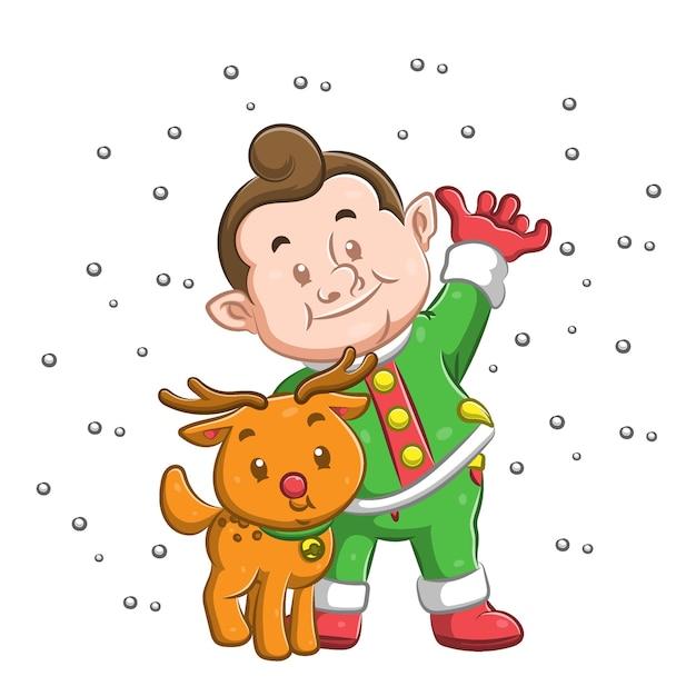 Ragazzo in piedi sotto la neve e usando il cappotto verde caro il suo cane Vettore Premium