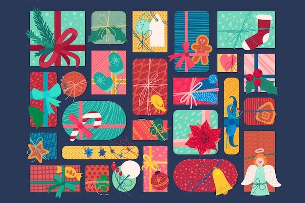 Illustrazione piana delle caselle del presente di nuovo anno luminoso. set di adesivi di regali e dolcetti di natale Vettore Premium
