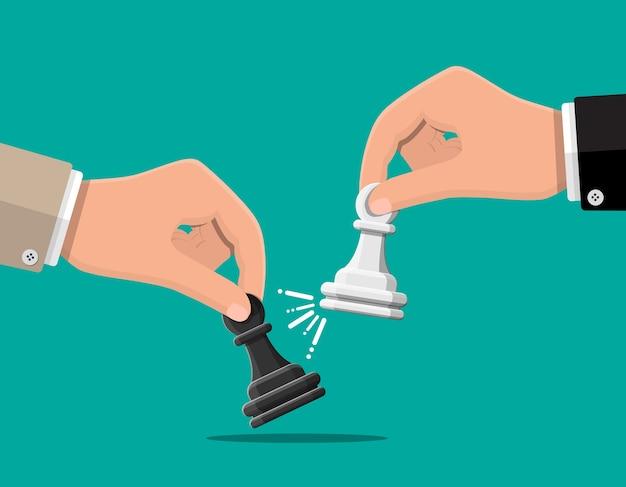 Uomo d'affari che tiene in mano la figura di scacchi pwan. definizione degli obiettivi. obiettivo intelligente. obiettivo aziendale, concorrenza, concetto di gestione. realizzazione e successo. Vettore Premium