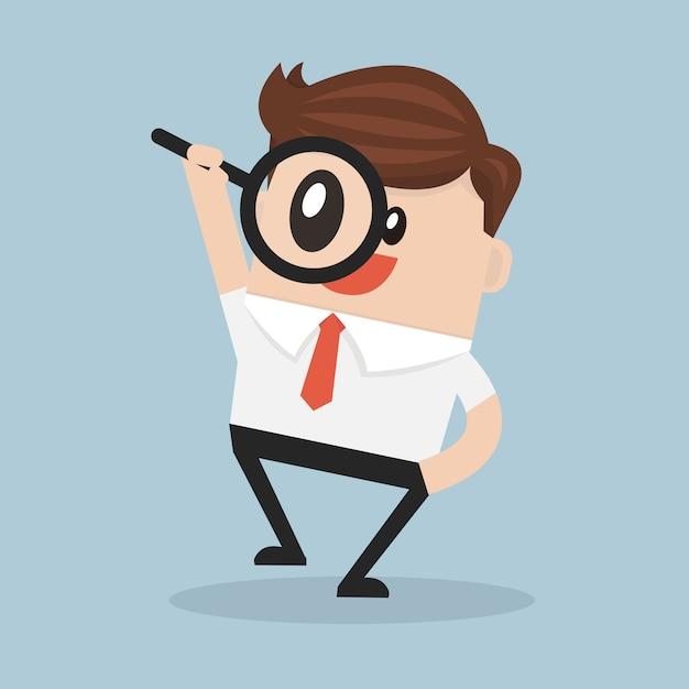 Uomo d'affari guardando attraverso una lente di ingrandimento. Vettore Premium
