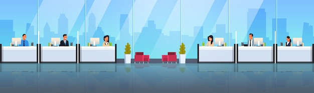 Cassieri seduti alle finestre della cassa Vettore Premium