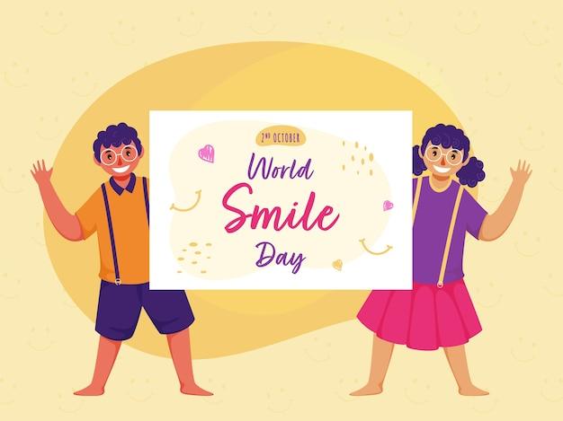 Ragazzo allegro e ragazza che tengono una carta del messaggio della giornata mondiale del sorriso sul fondo giallo del modello di faccina sorridente. Vettore Premium
