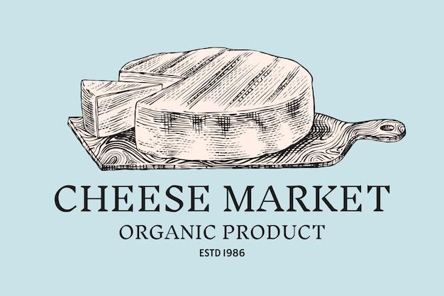 Distintivo di formaggio. logo vintage per mercato o drogheria. prodotto lattiero-caseario su una tavola di legno. Vettore Premium