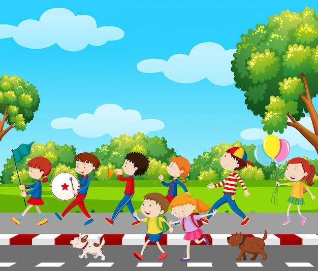 Bambini in banda in marcia nel parco Vettore Premium