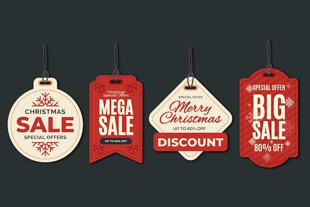 Collezione di tag di vendita di natale in design piatto Vettore Premium