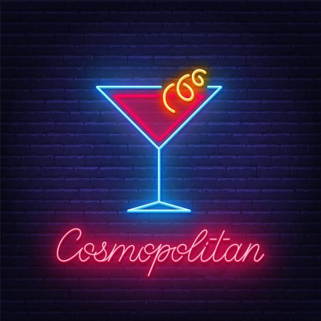 Cocktail cosmopolitan insegna al neon sulla priorità bassa del muro di mattoni. Vettore Premium